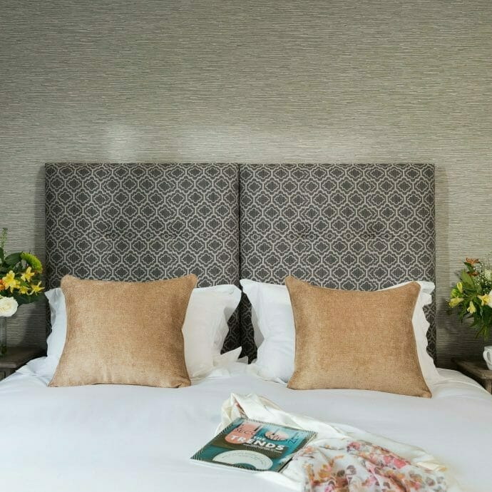 Guest Bedroom with Gold Cushions and Bespoke Headboard