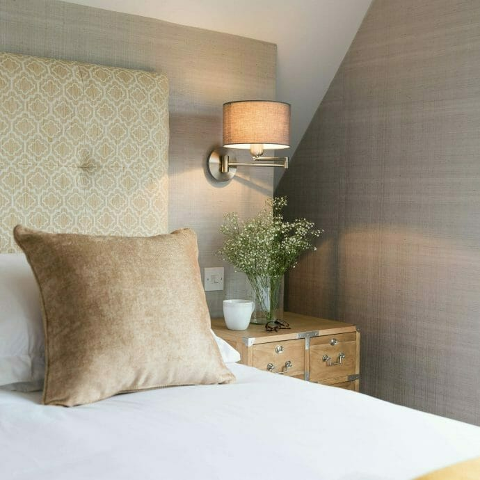 Soft grey master bedroom with navy colefax and fowler roman blind made to measure