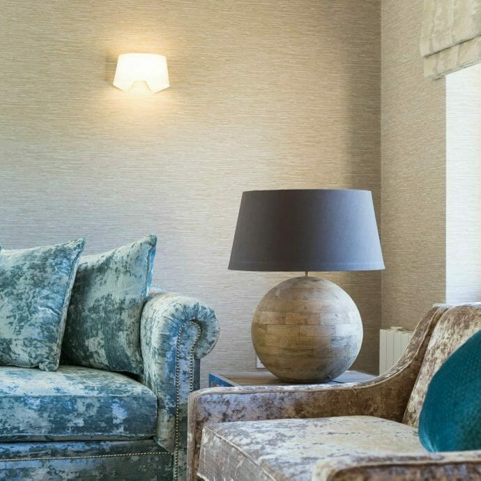 Blue and Taupe Velvet Sofas in Living Room by Camellia with Jane Churchill Wallpaper in Polzeath