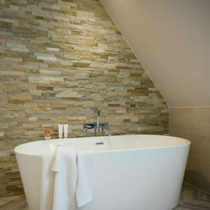 Natural Stone Wall with Freestanding bath in North Cornwall.