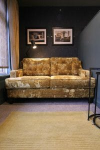 Bespoke compact sofa covered in gold crushed velvet